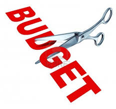 "Image of scissors cutting the word ""budget"""